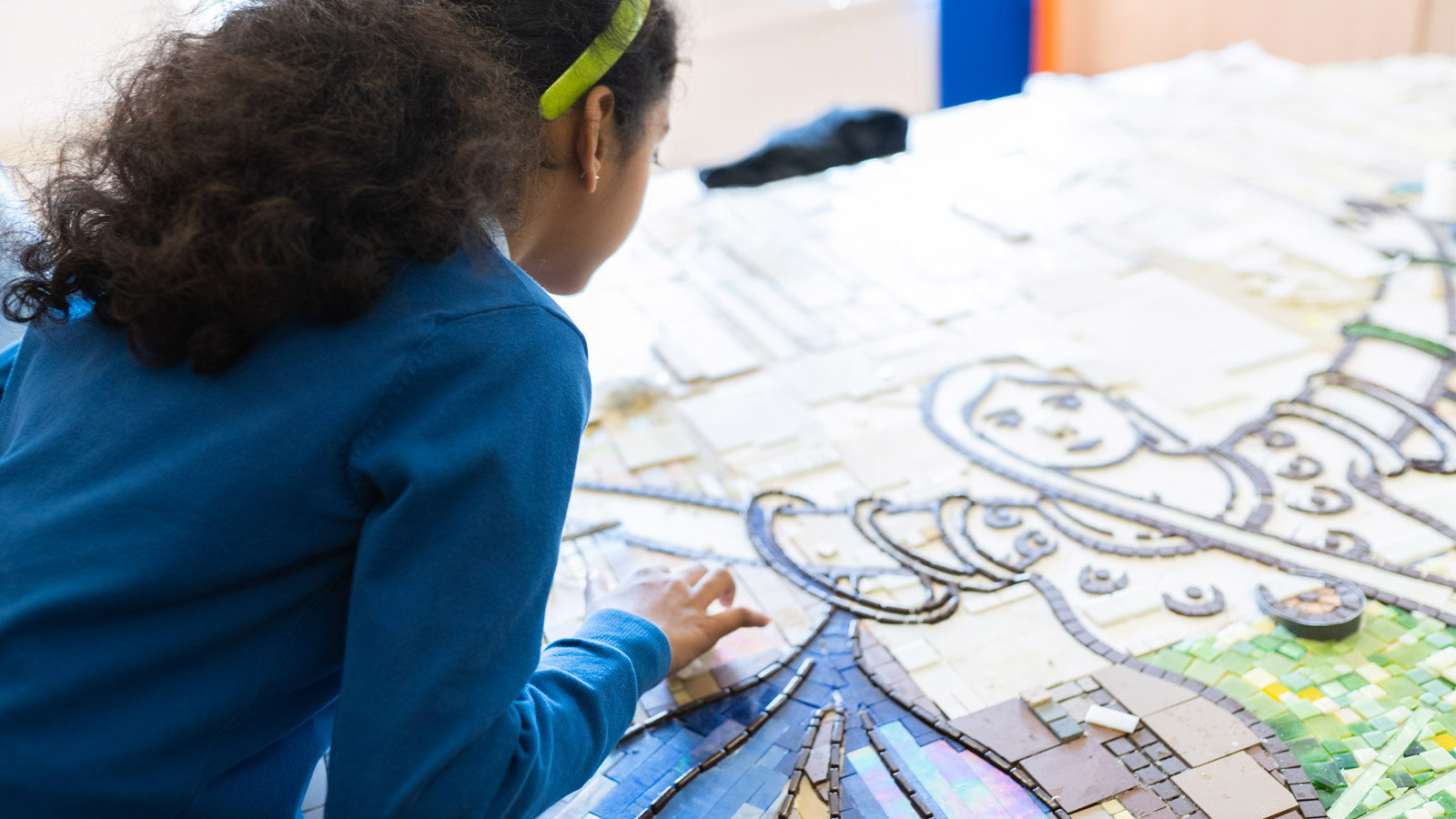 Child making mosaic